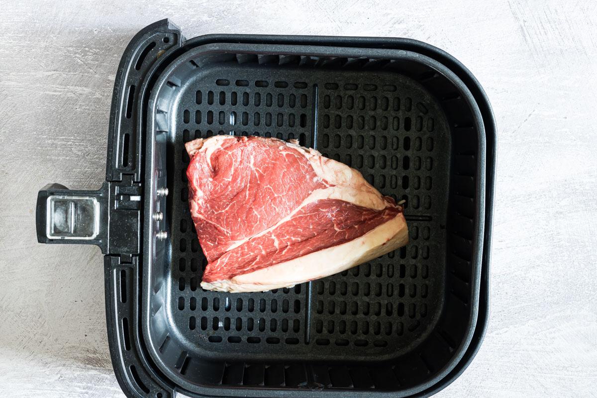 top down view of steak inside the air fryer