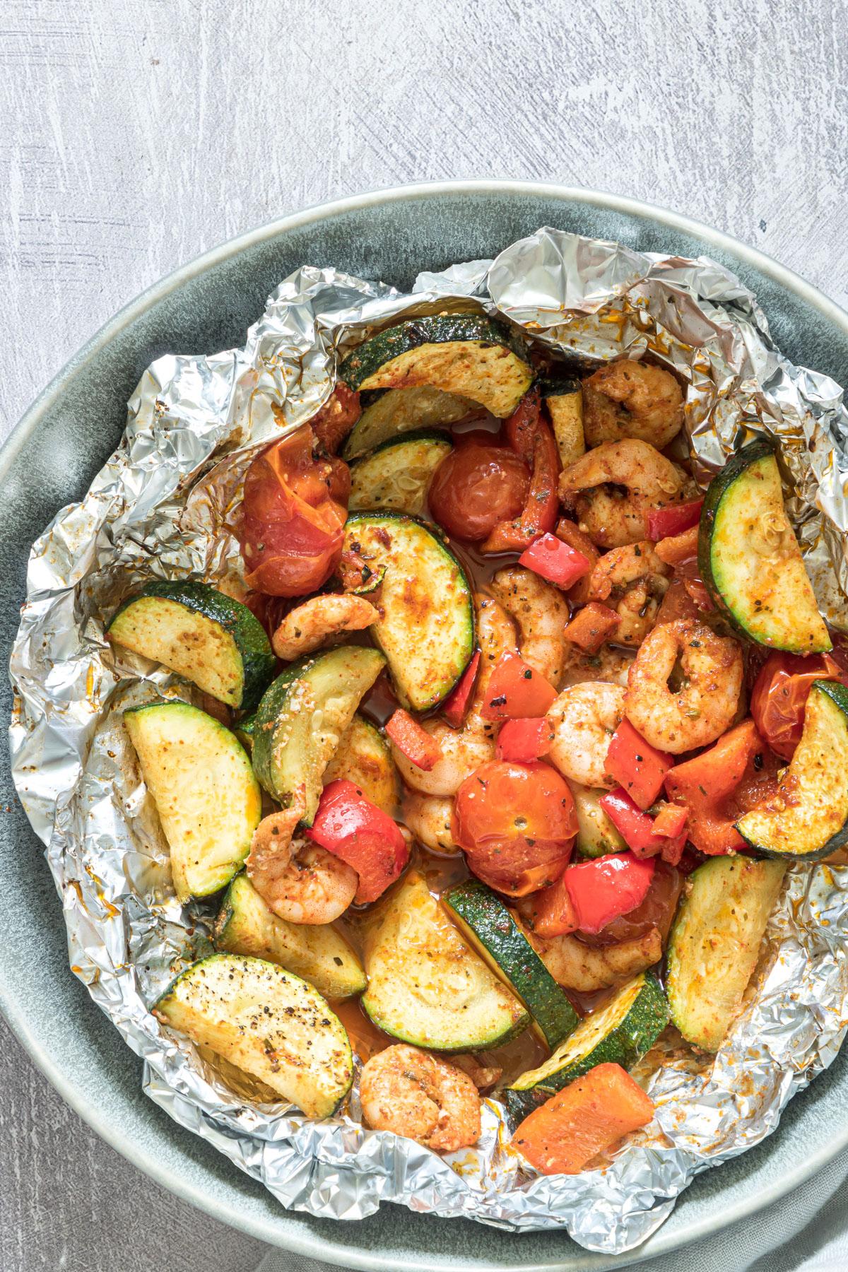 cooked shrimp foil packs in aluminium in a bowl