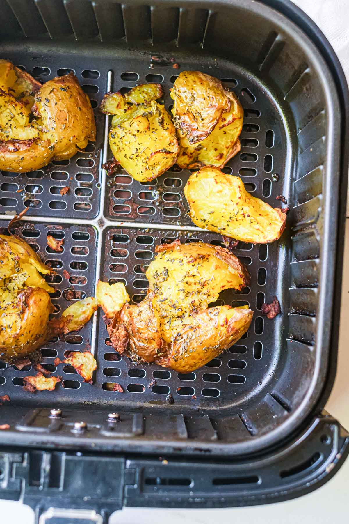 Cooked Air fryer smashed potatoes in an air fryer