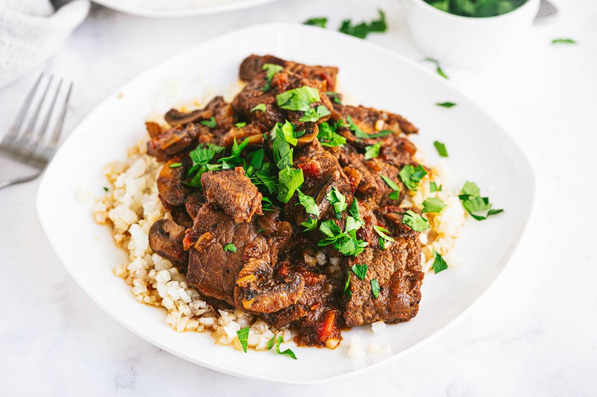 one serving of the completed instant pot swiss steak recipe