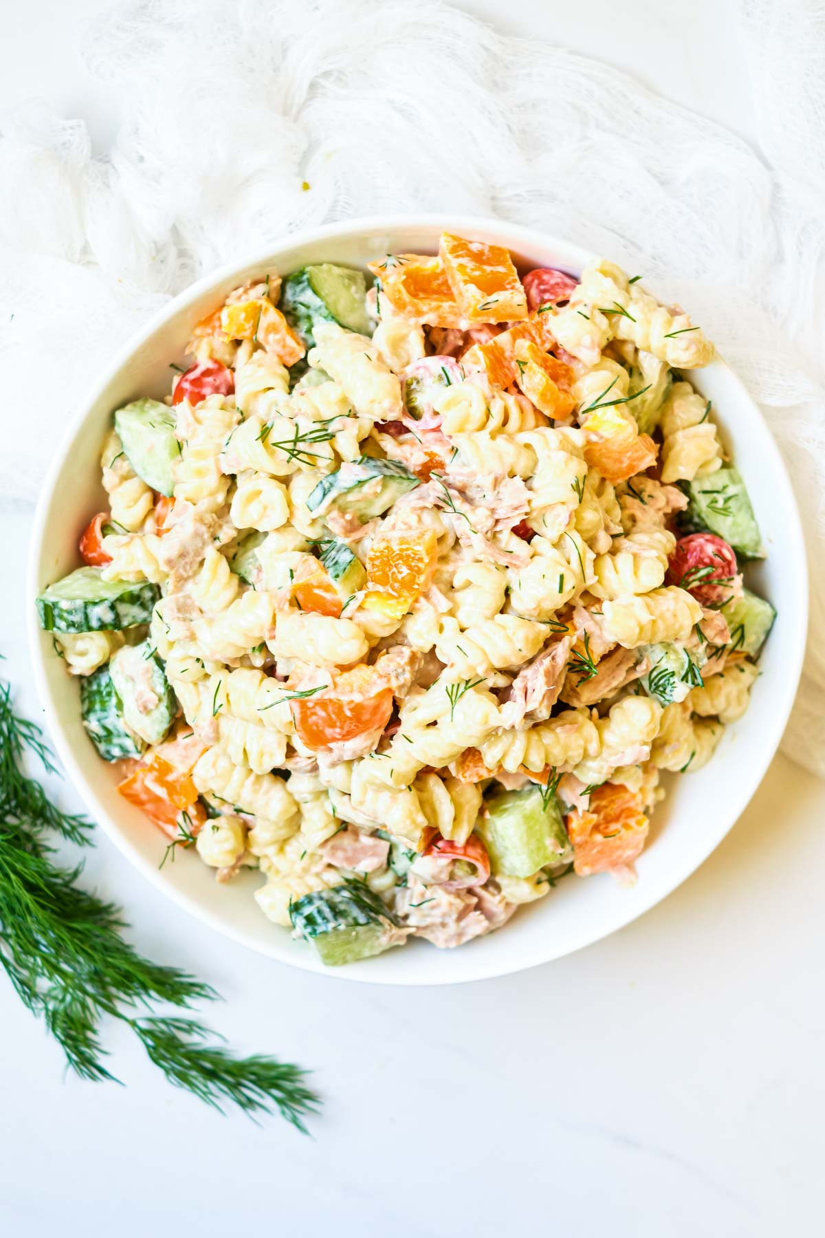 close up of a bowl of creamy Instant pot tuna pasta salad with vegetables and creamy dressing and dill