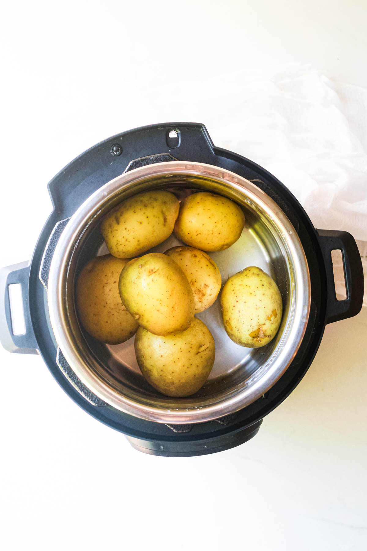 Potatoes in an instant pot ready to be cooked