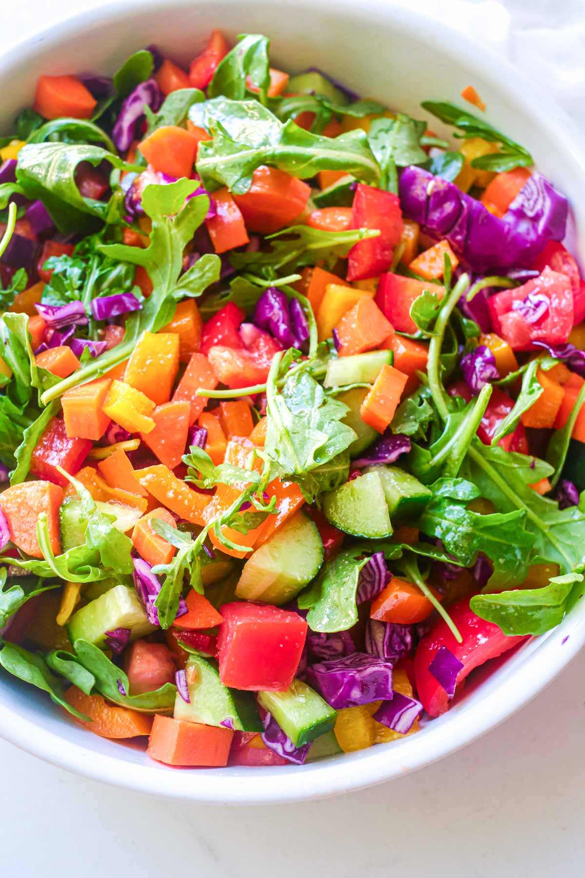 close up of a colorful chopped salad in a bowl on a table