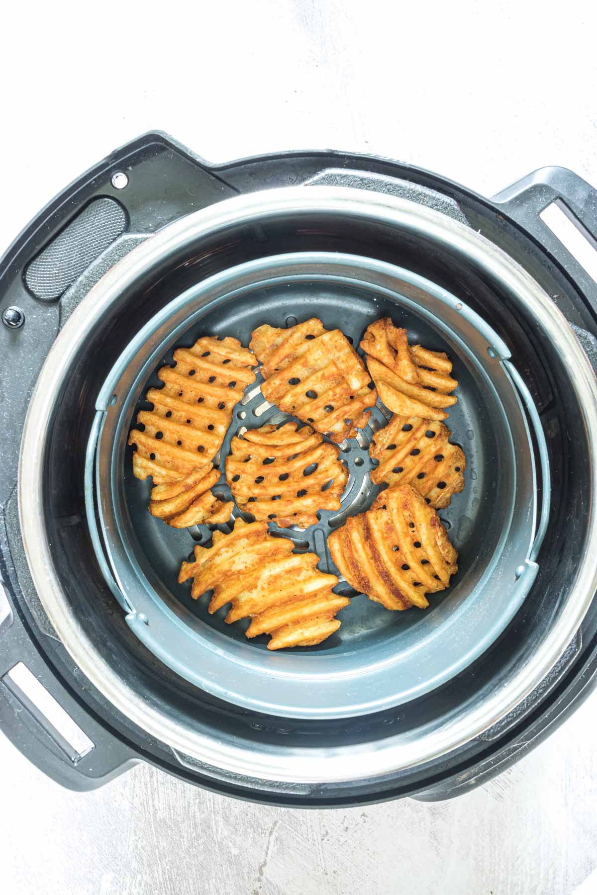 top down view of frozen waffle fries inside the instant pot