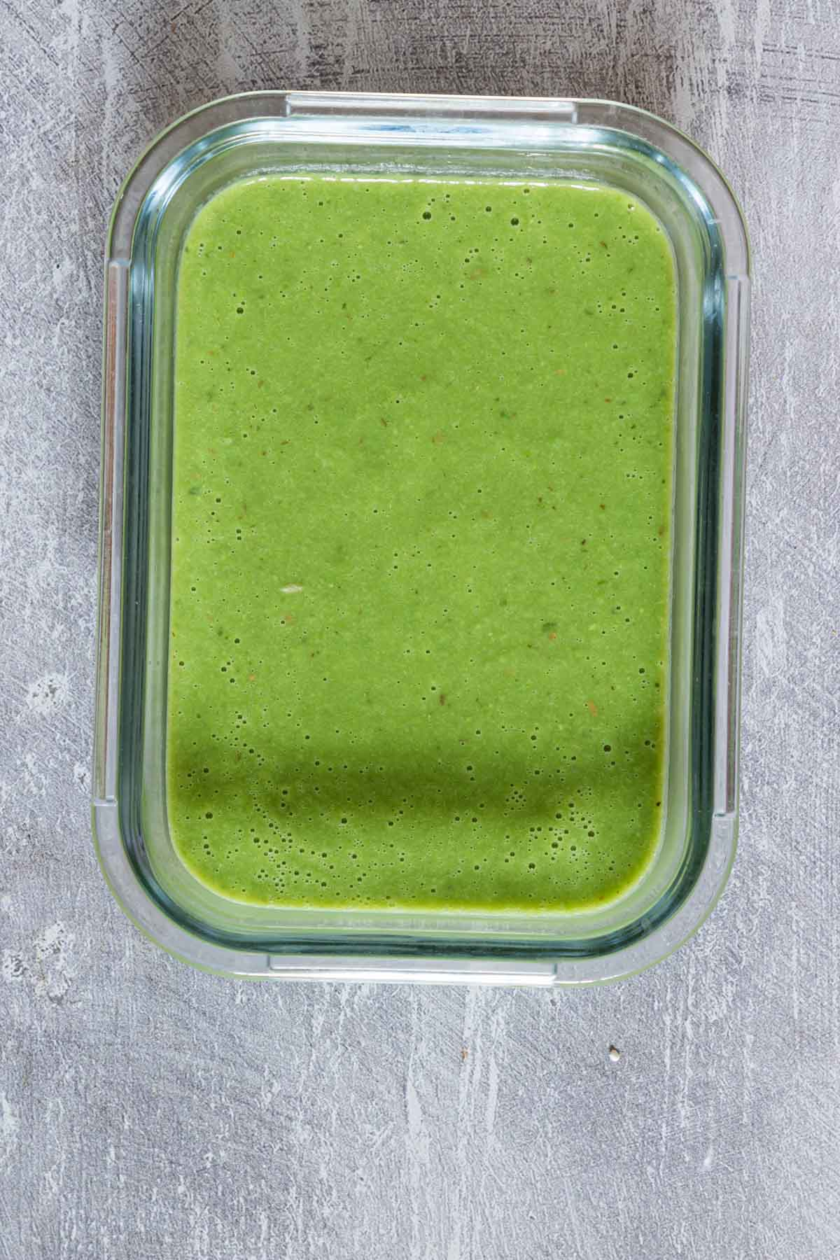 glass meal storage container filled with pea soup