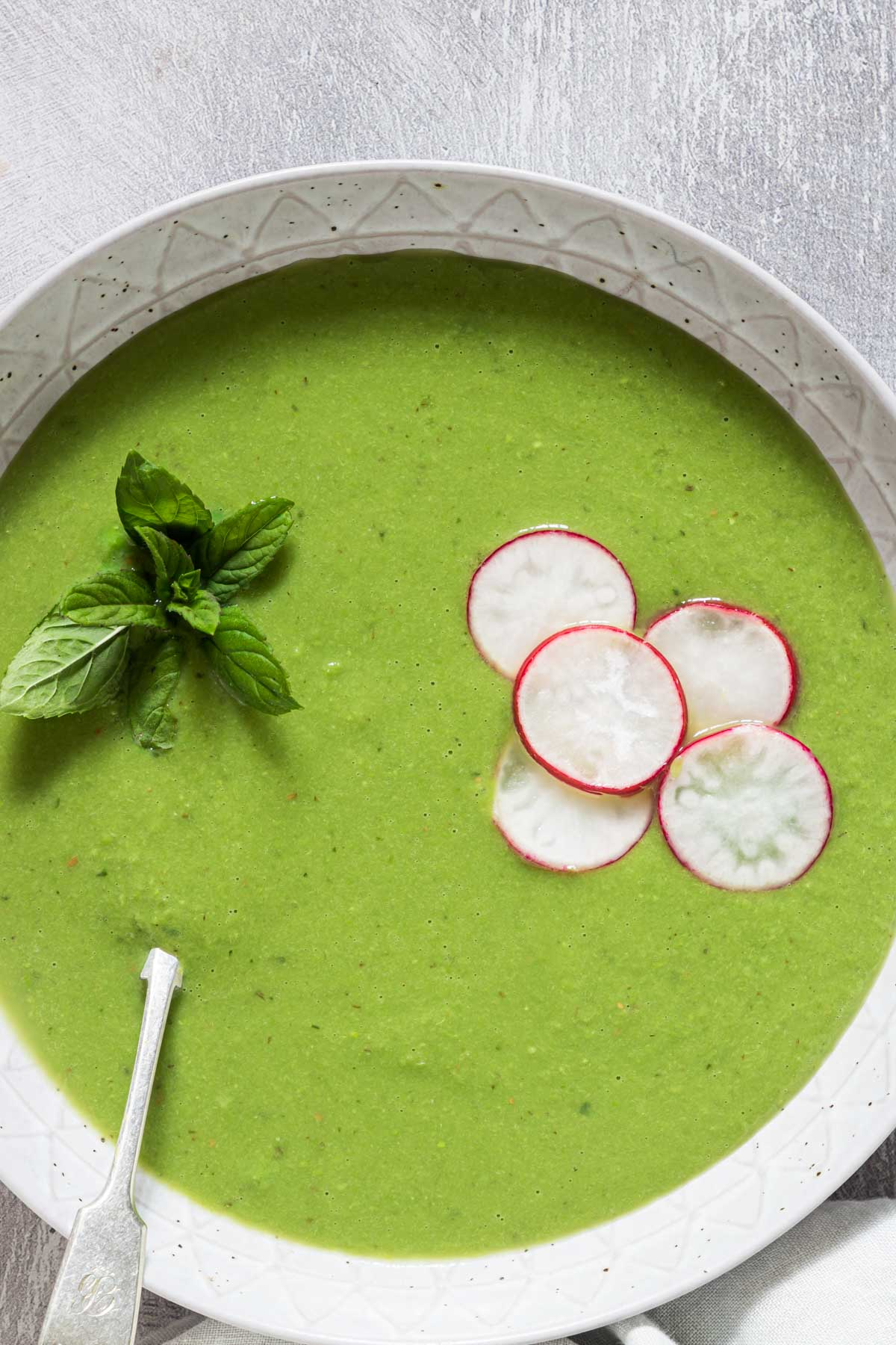 top down view of a bowl filled with pea soup