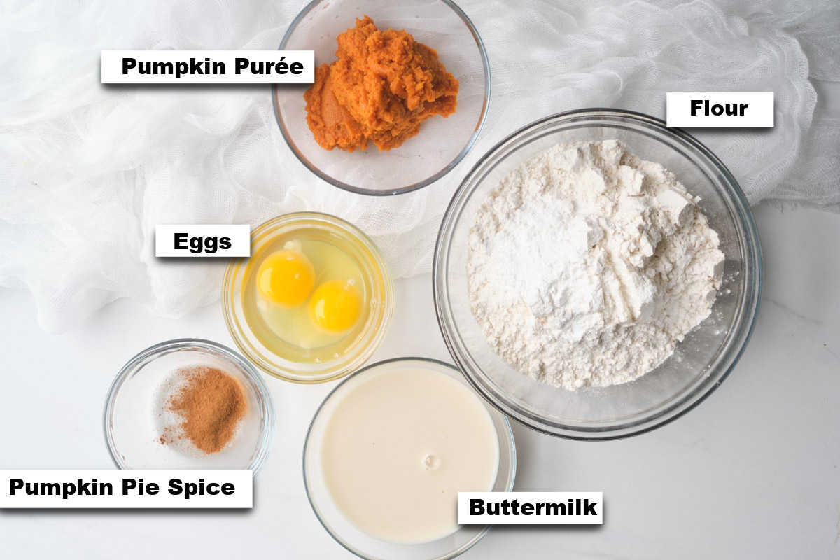 the ingredients needed for making fluffy pumpkin waffles