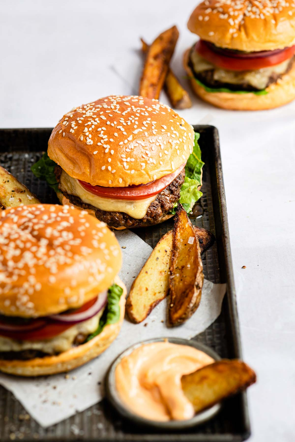 top down view of the finished venison burgers served with potato wedges