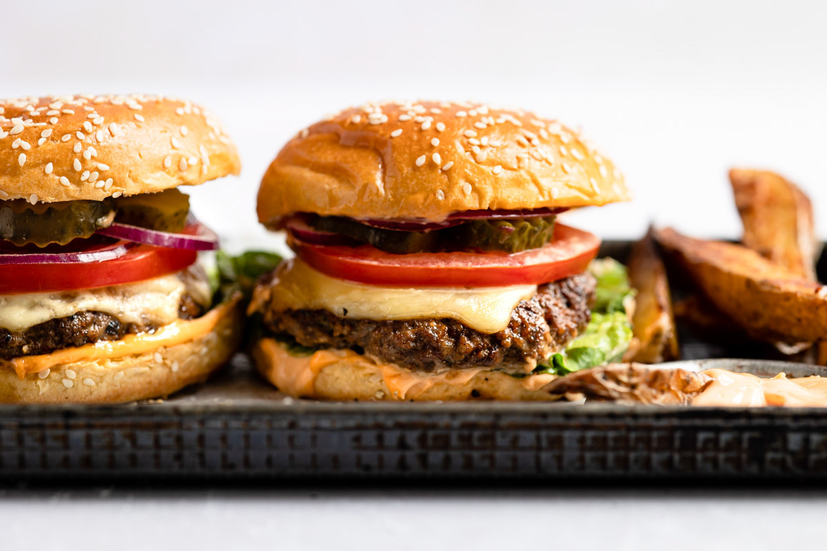 two venison burgers on a tray