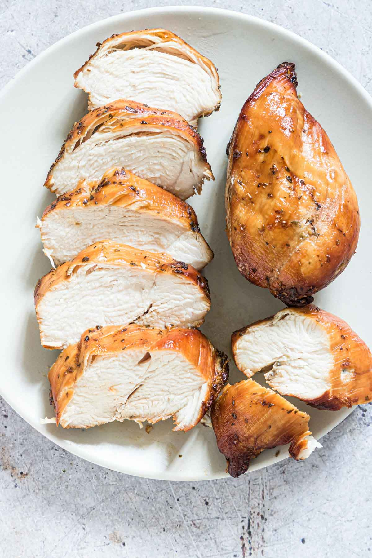 a plate filled with the cooked air fryer frozen chicken breast