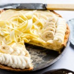 the finished banana cream pie with one slice removed