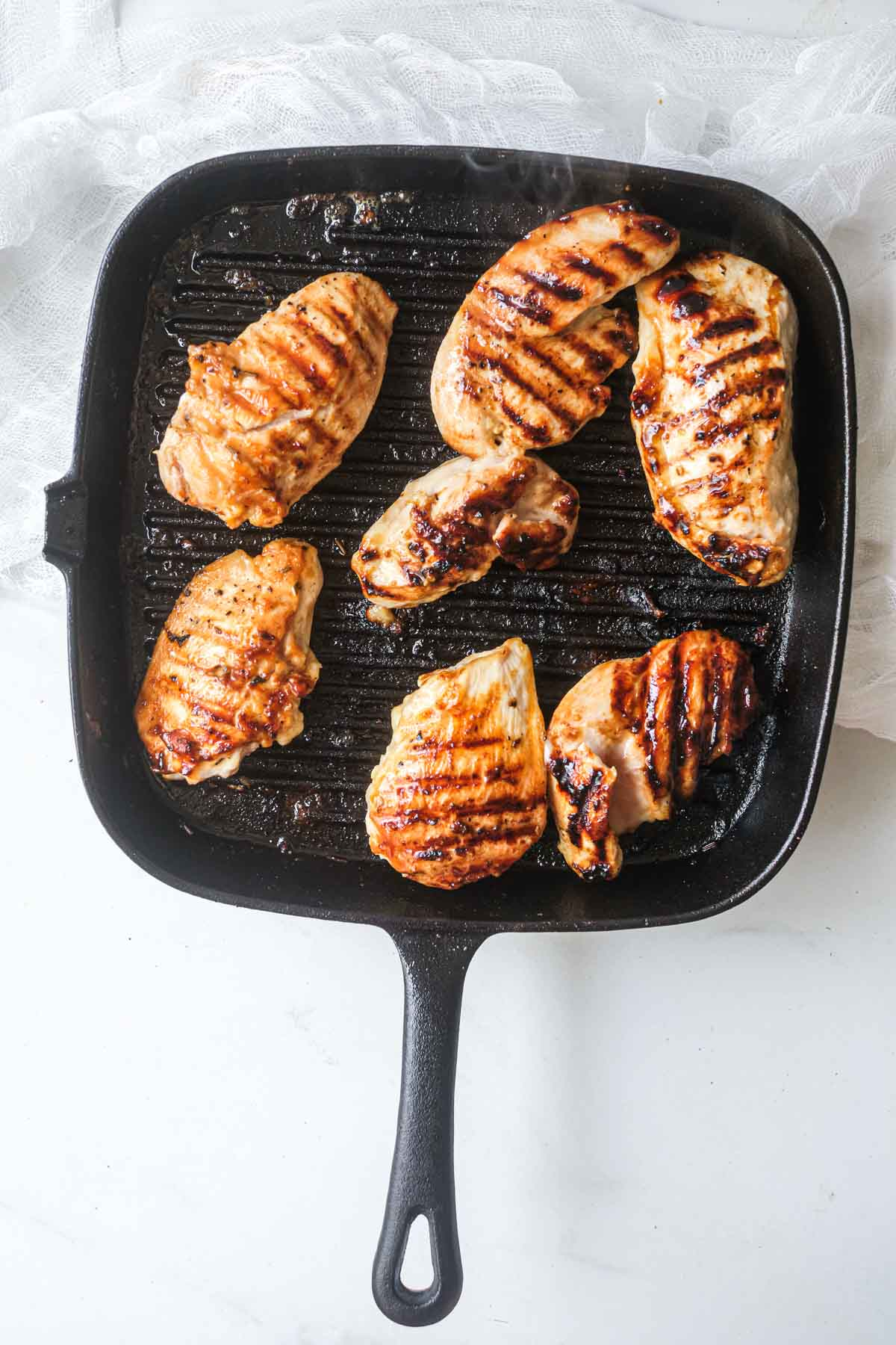 top down view of the grilled chicken tenders in a grill pan