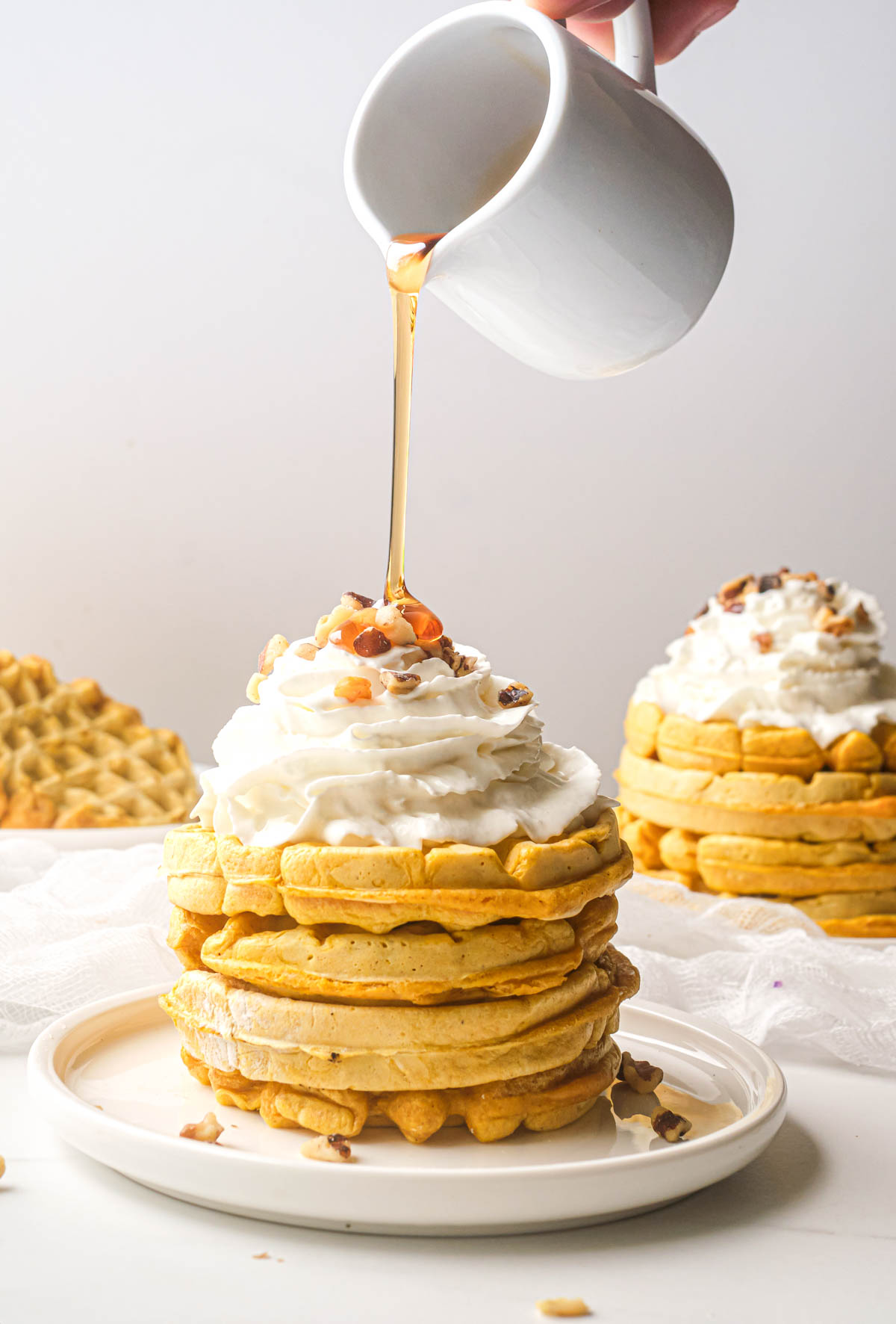 the finished pumpkin waffles ready to be served
