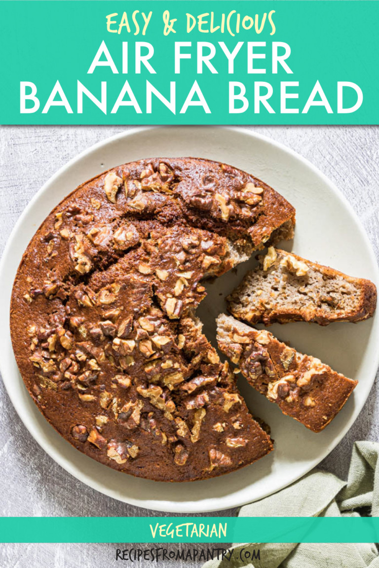a round banana bread with slices removed on a plate