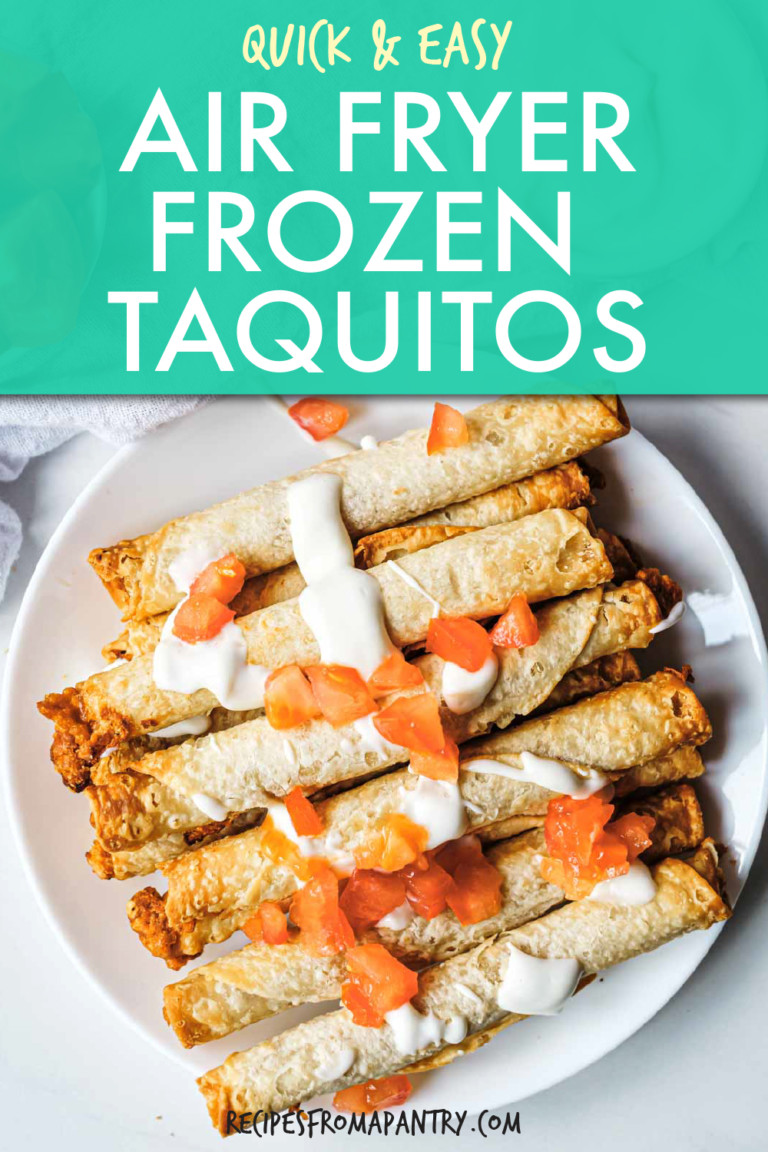 taquitos on a plate topped with tomatoes and cream