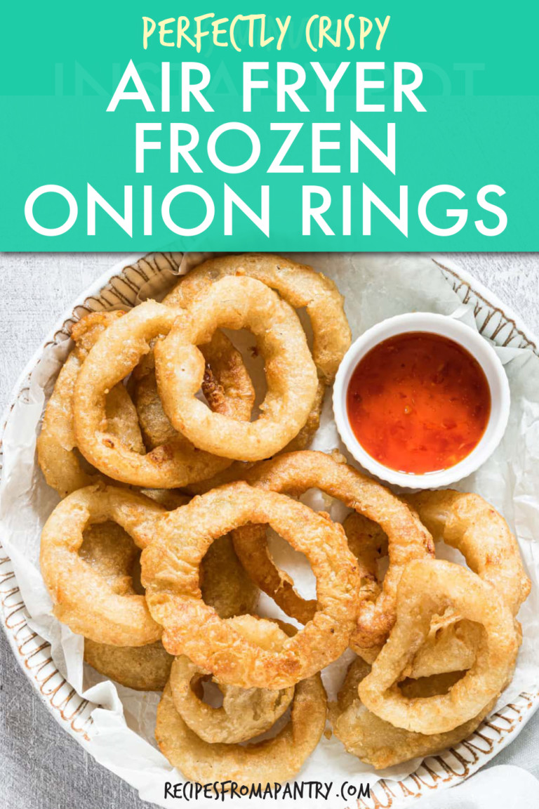 onion rings on a plate with a side of sauce