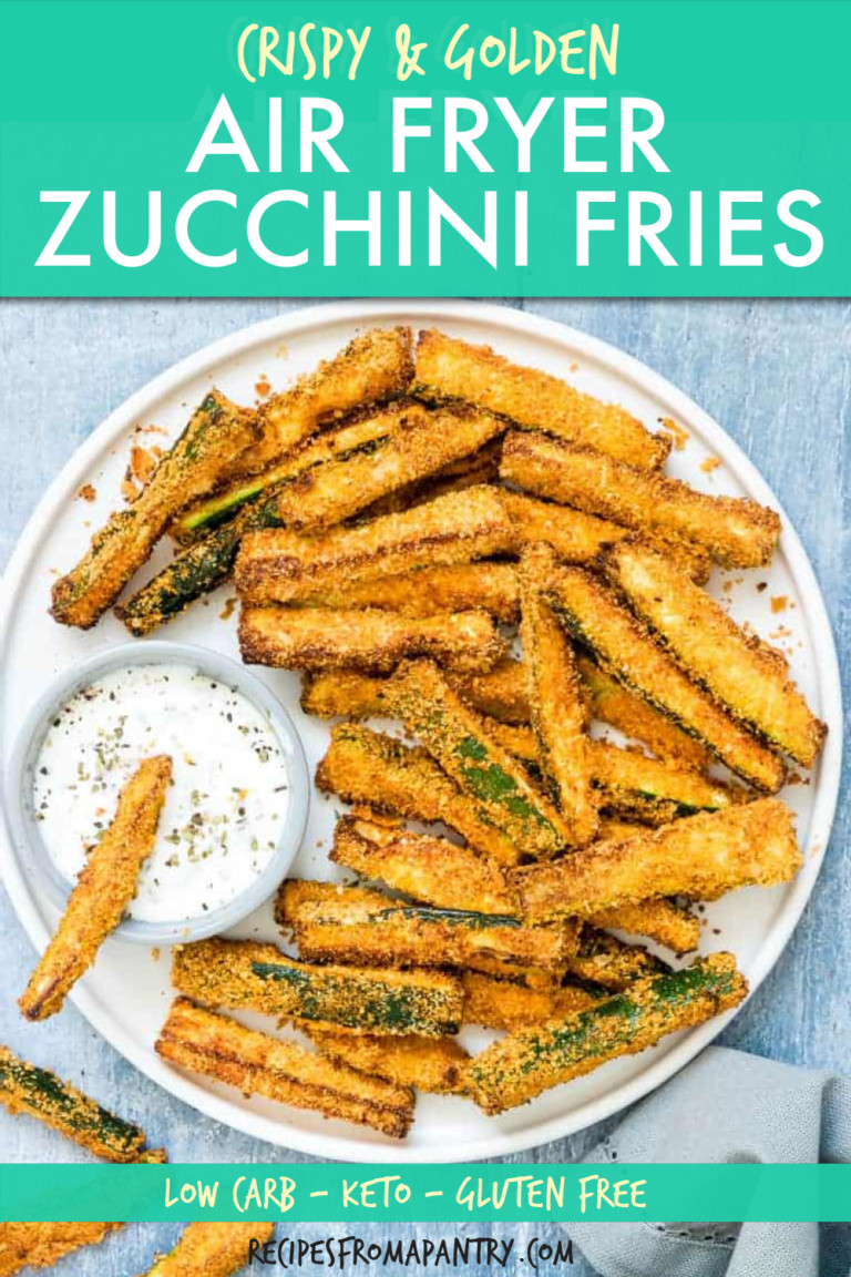 top down view of zucchini fries on a plate with sauce on the side