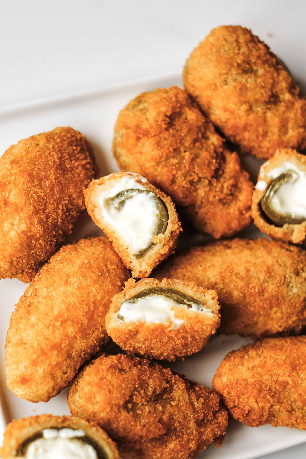 close up view of the finished frozen jalapeno poppers in air fryer