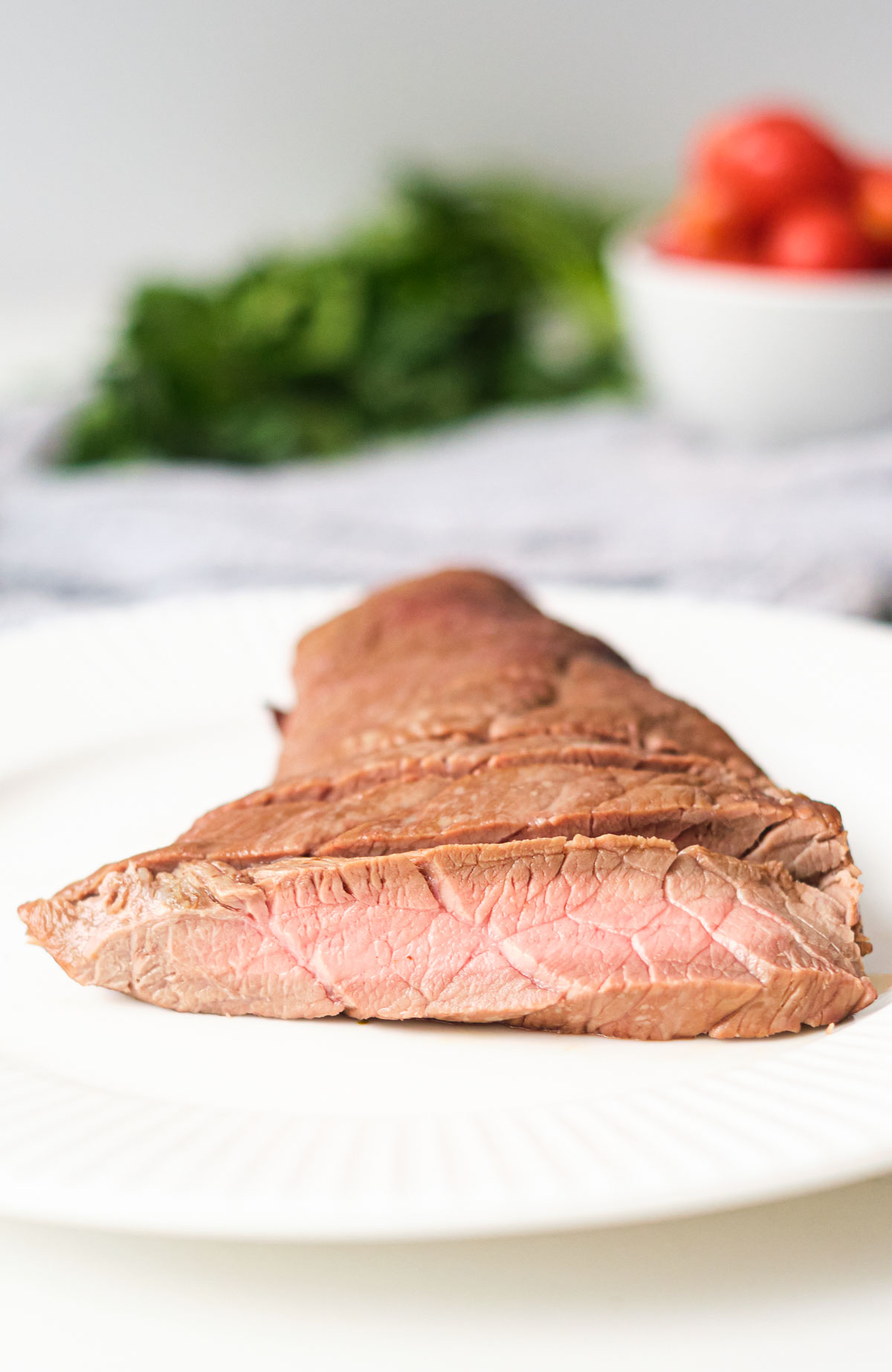 steak that has been reheated in air fryer and served on a white plate