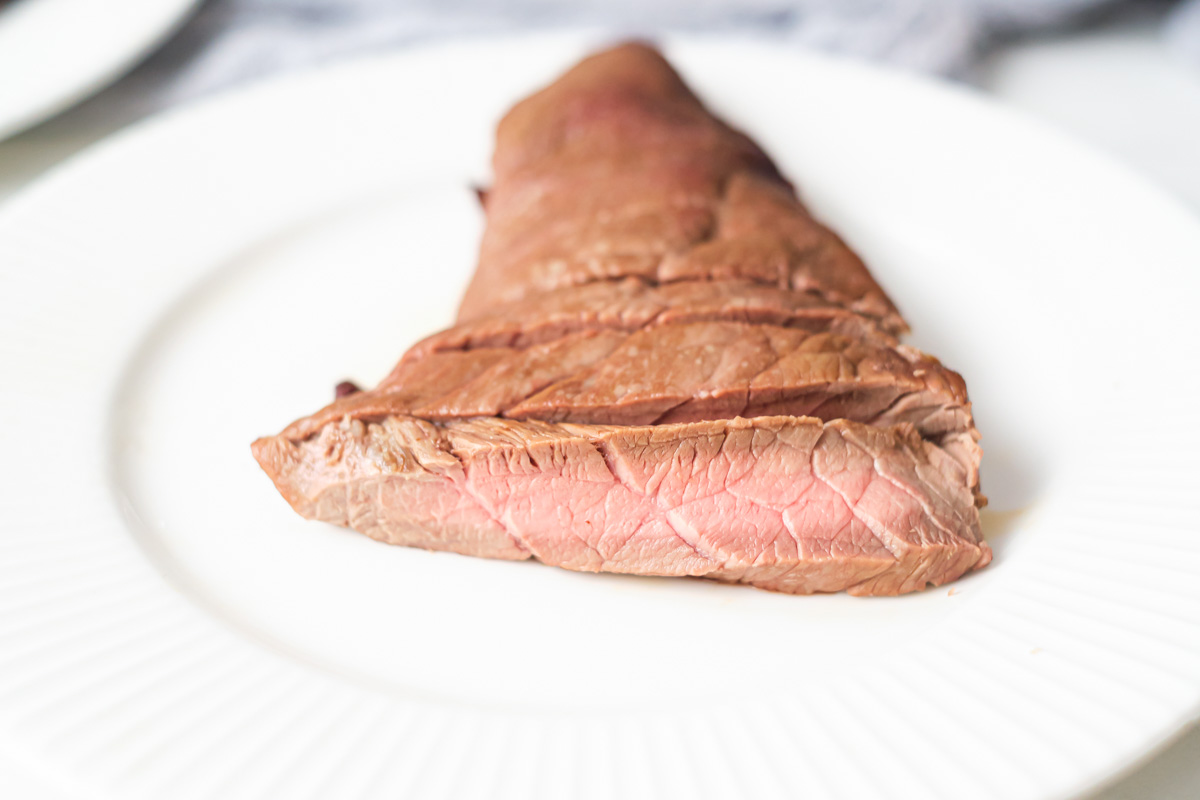 close up view of a piece of the finished product when you reheat steak in air fryer