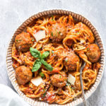 a bowl of slow cooker spaghetti and meatballs