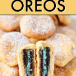 a stack of fried oreo cookies with one cut in half to show the cream inside