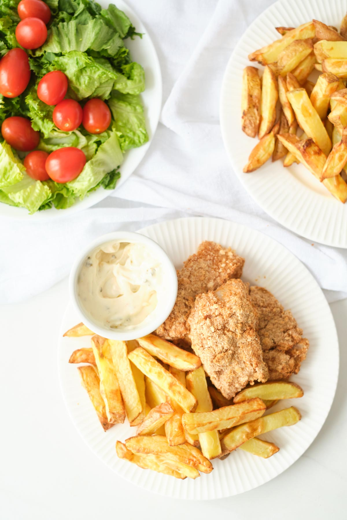 air fryer fish and chips served with a green salad