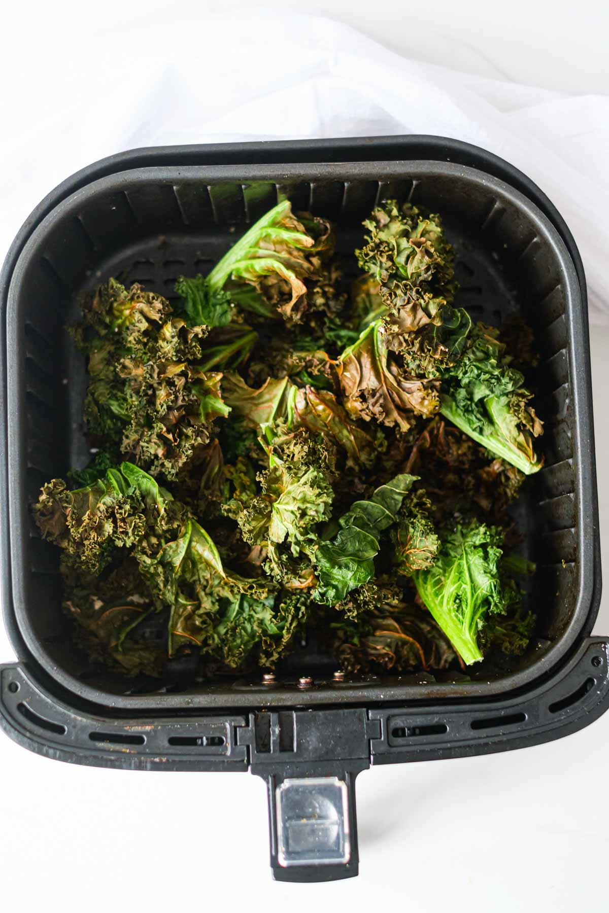 top down view of the kale chips in air fryer basket