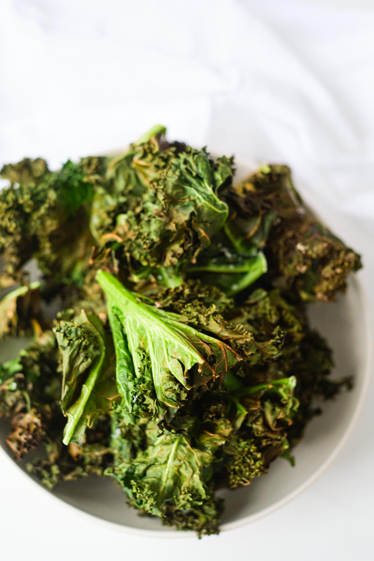 top down view of a bowl filled with air fryer kale chips