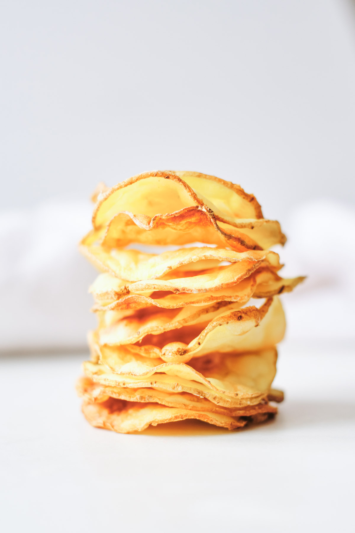 air fryer potato chips stacked vertically