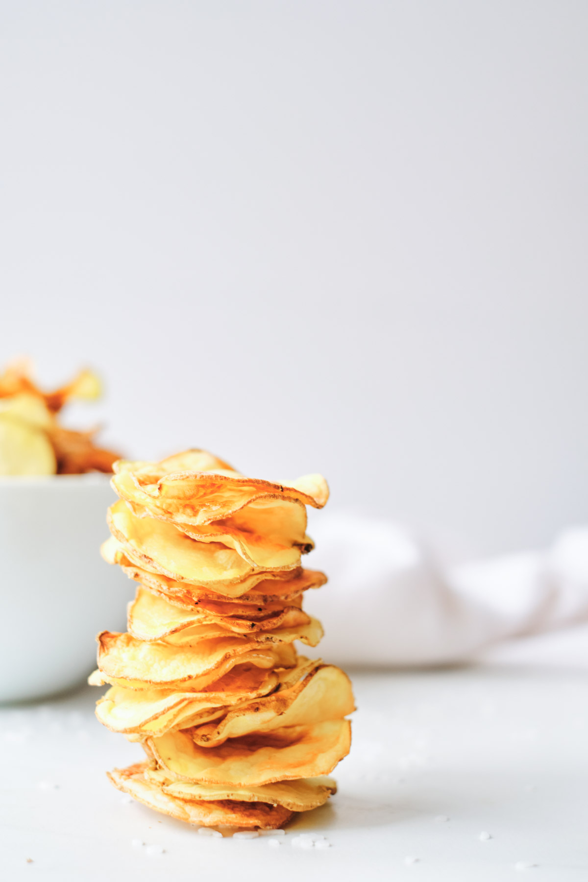 the finished air fryer potato chips stacked and ready to serve