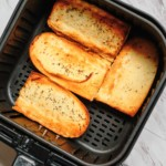 top down view of the frozen garlic bread in air fryer basket cooked and ready to be served