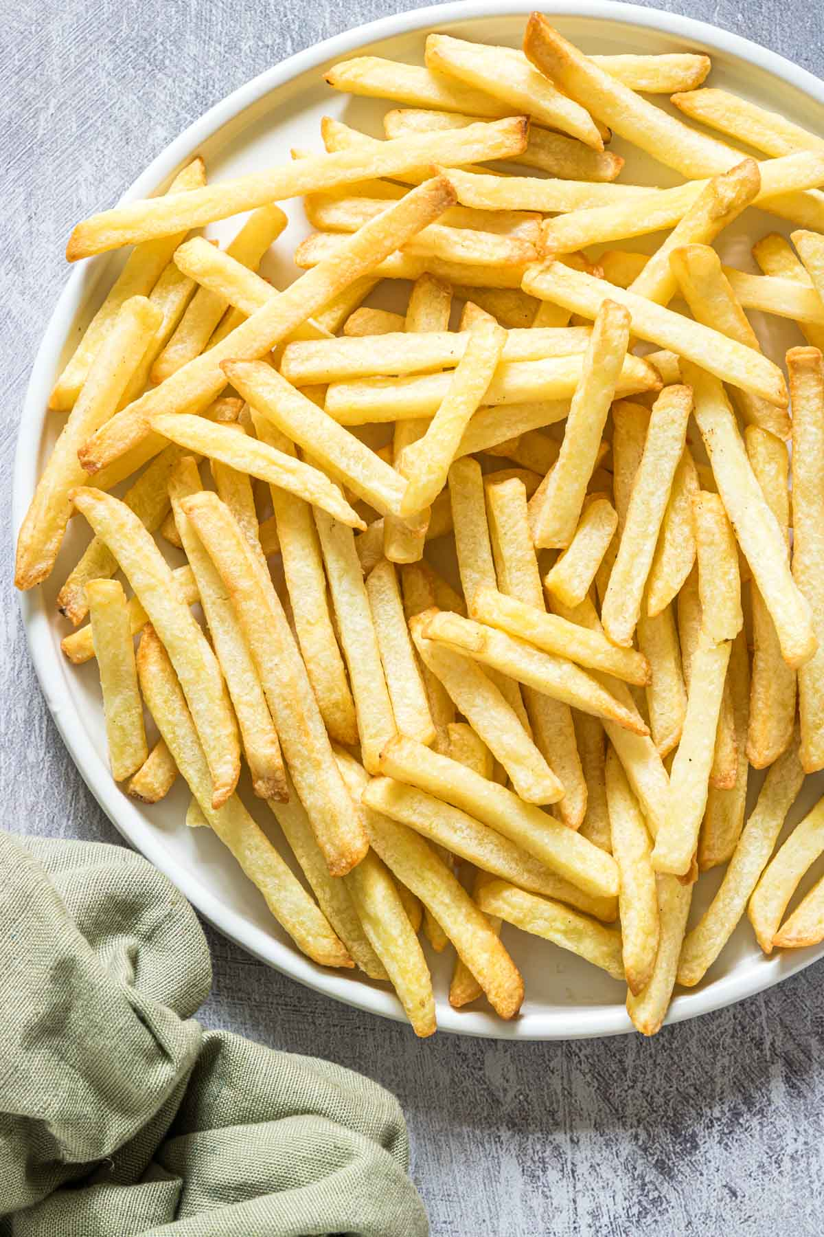 a white plate filled with air fryer reheat fries