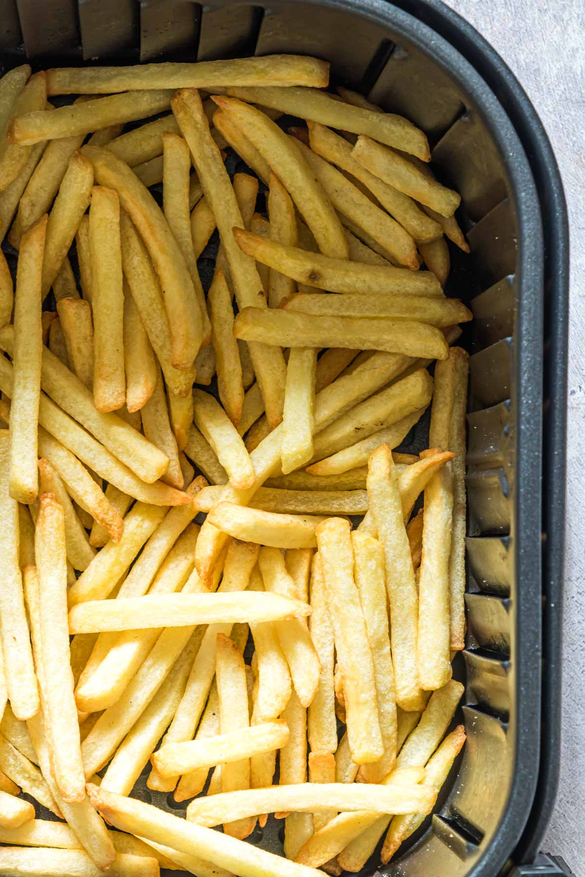 extreme close up of reheating fries in air fryer