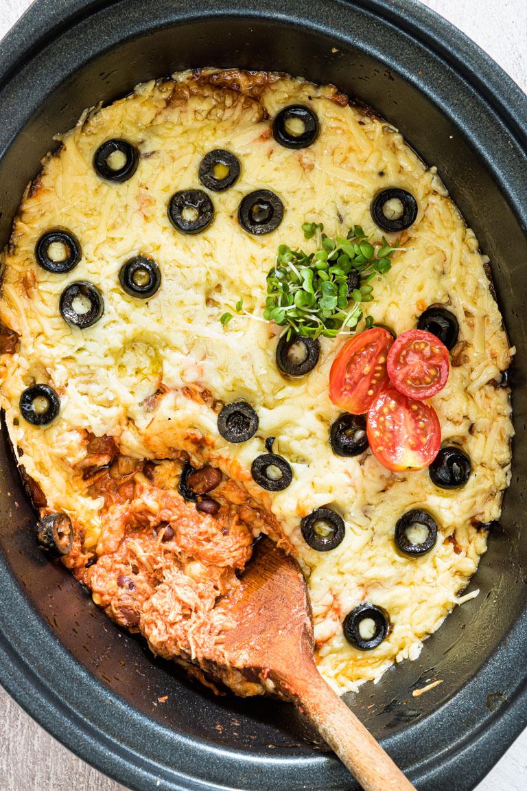close up of crockpot chicken enchilada casserole