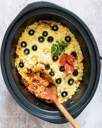 top down view of chicken enchiladas in a crock pot