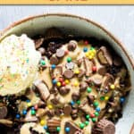 chocolate peanut butter cake in a bowl topped with ice cream