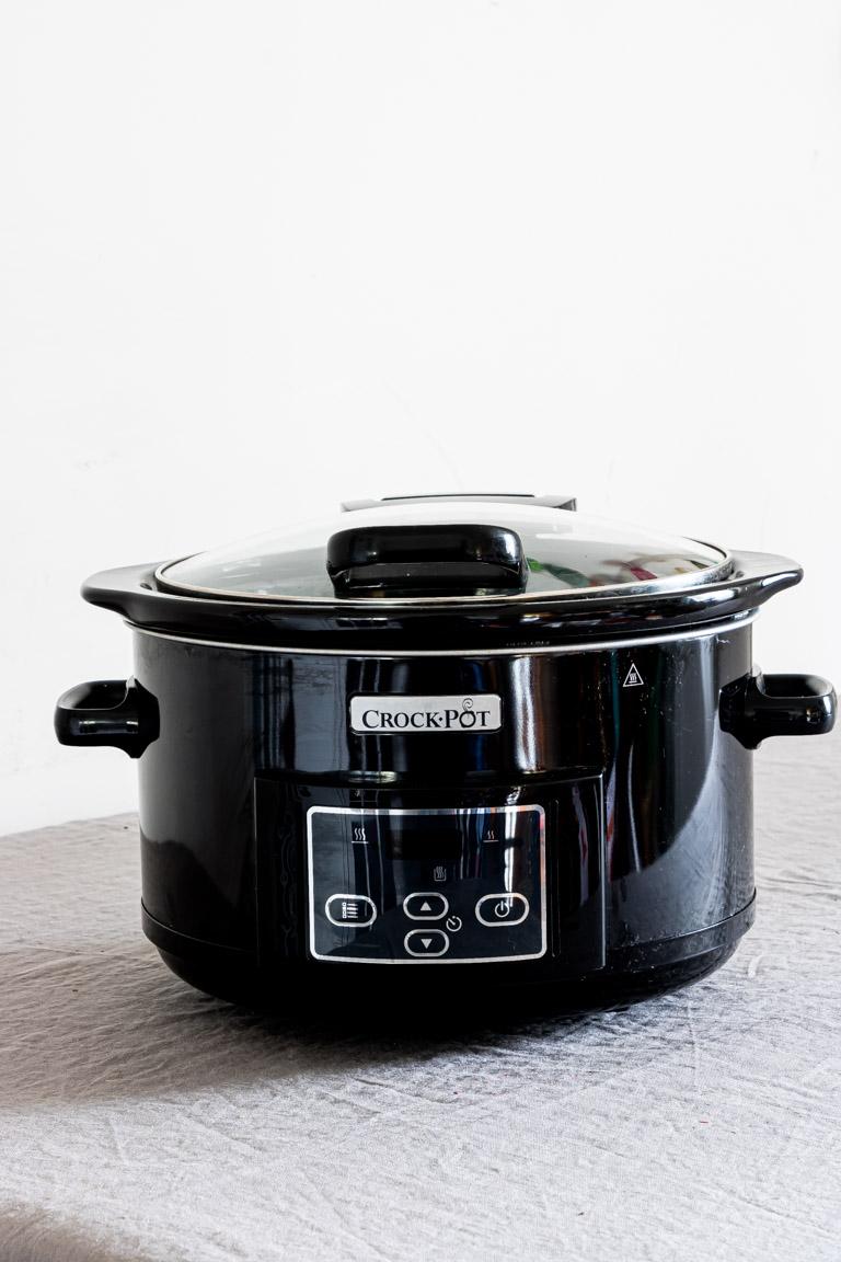 one black crockpot on a countertop