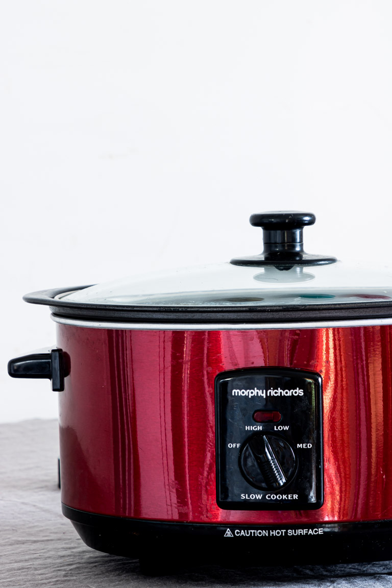 close up view of a red slow cooker