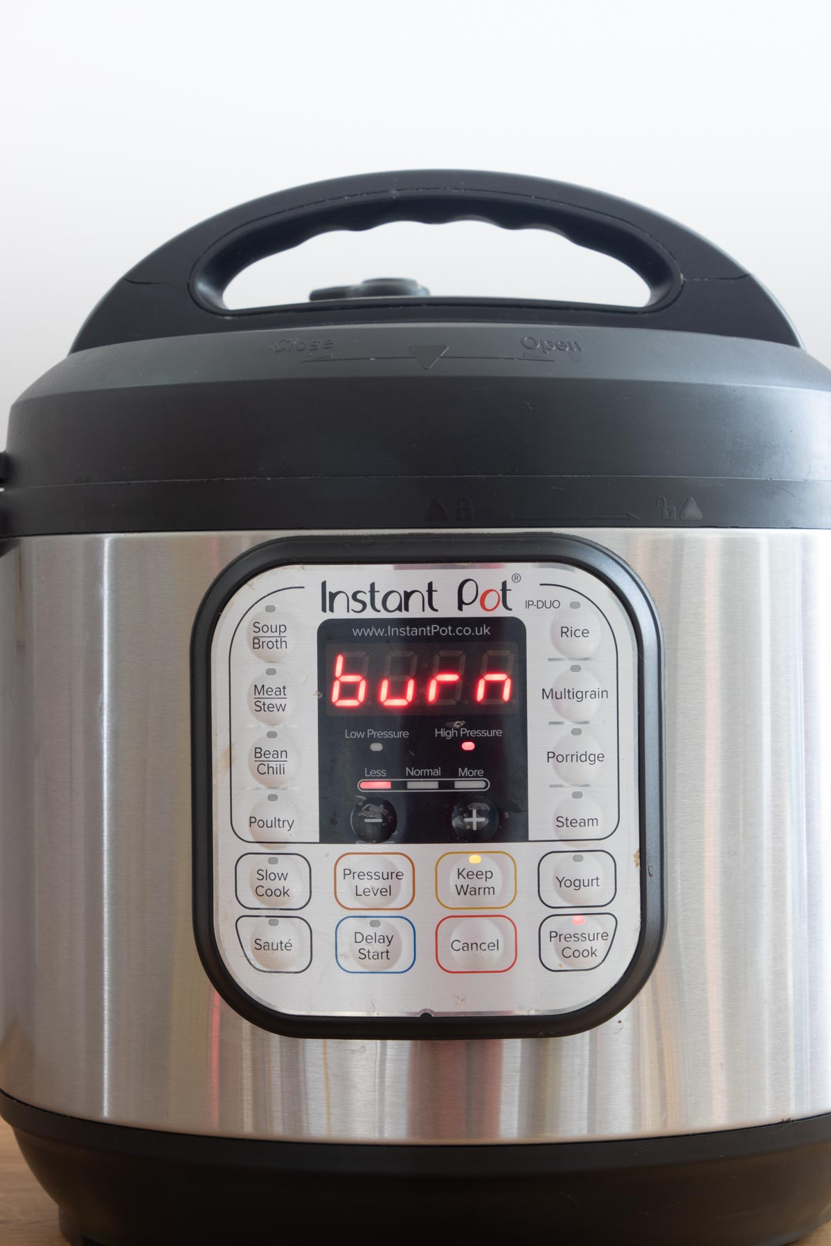 the front view of an instant pot burn message