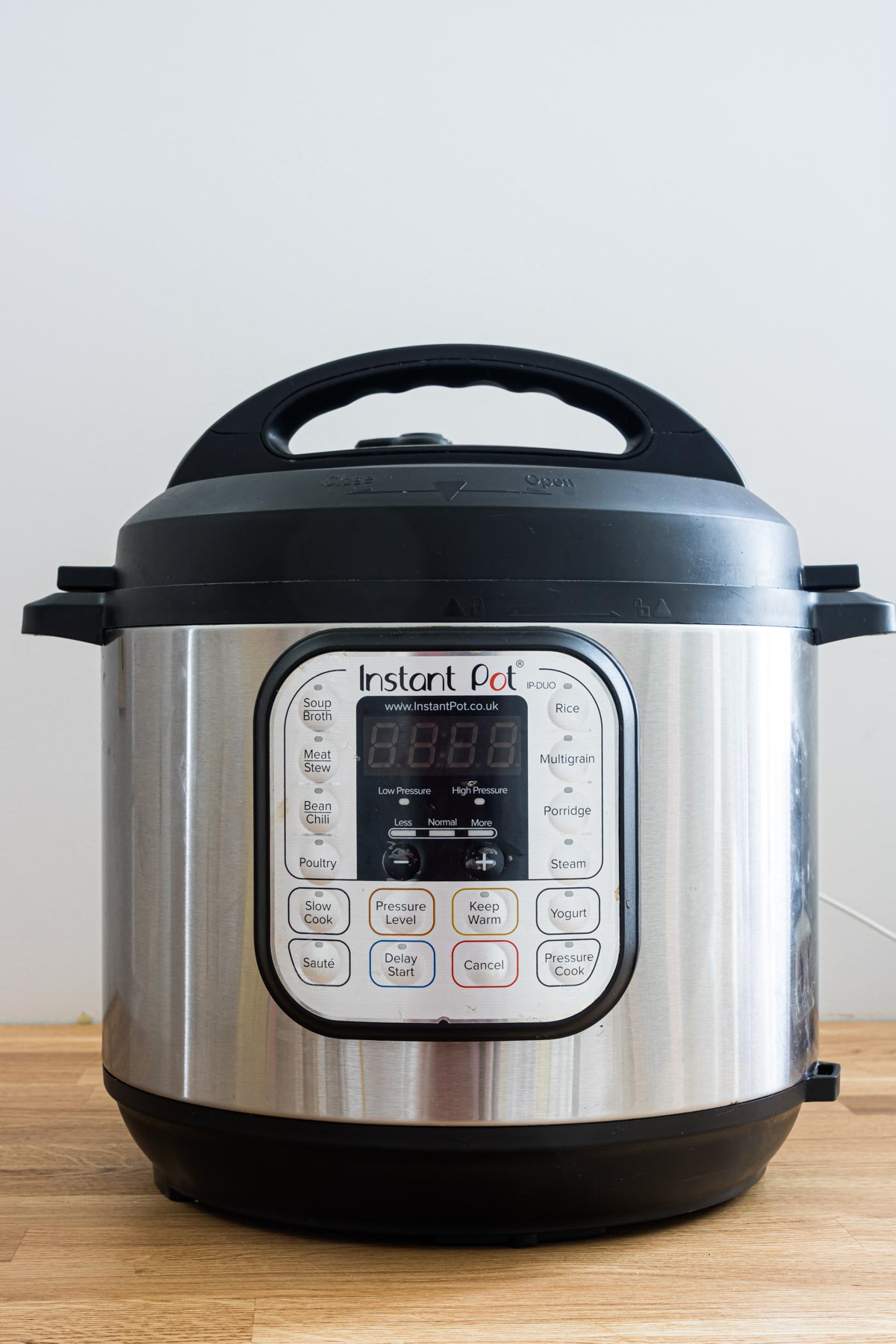 the front view of the instant pot buttons and settings panel