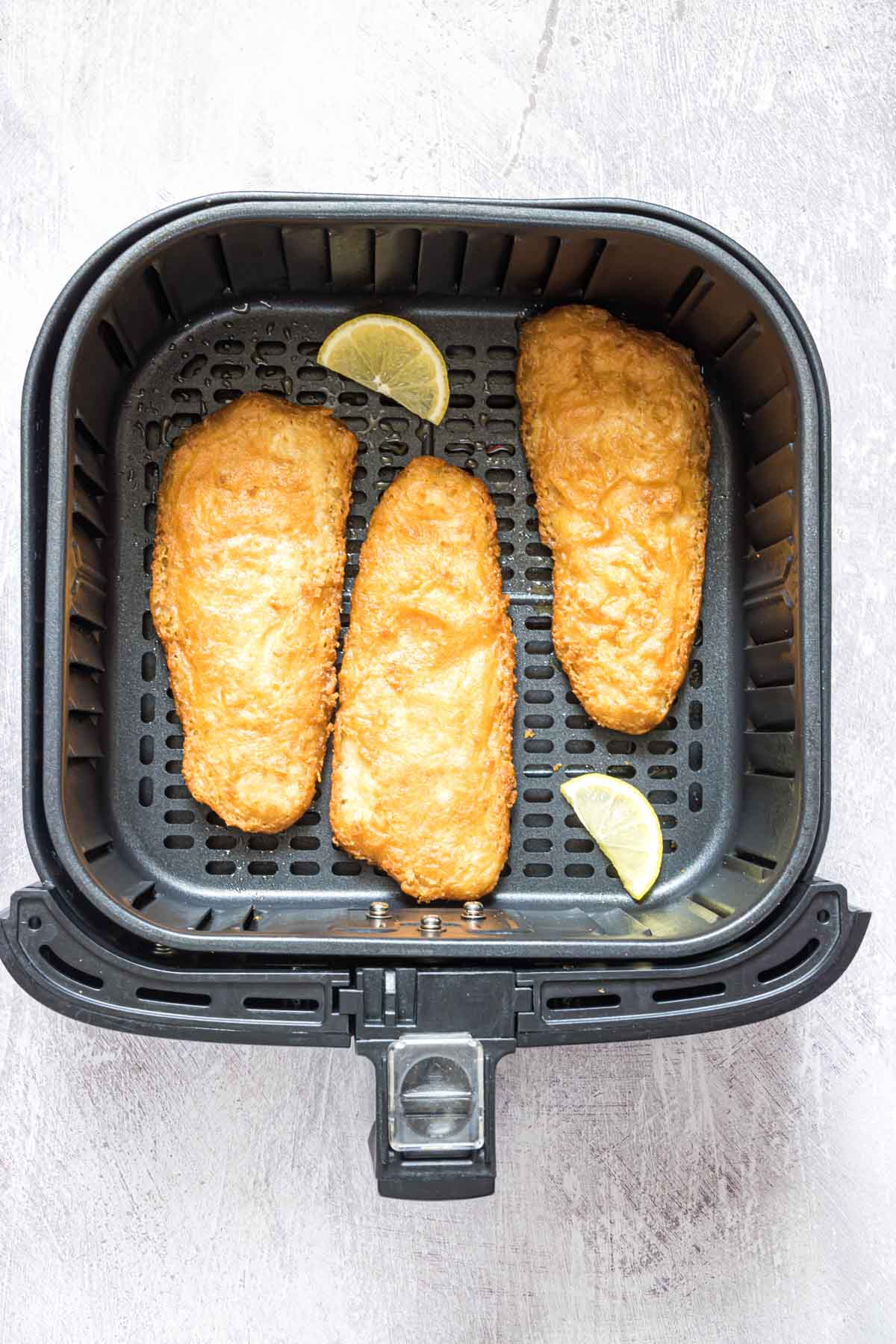 top down view showing how to reheat fried fish in air fryer