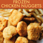 CHICKEN NUGGETS ON A PLATE WITH FRENCH FRIES
