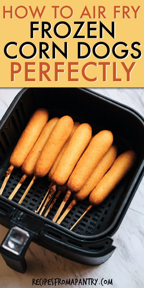 A GROUP OF CORN DOGS IN AN AIR FRYER