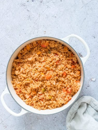 top-down view of Cinnamon Spiced Jollof Rice in a white pot