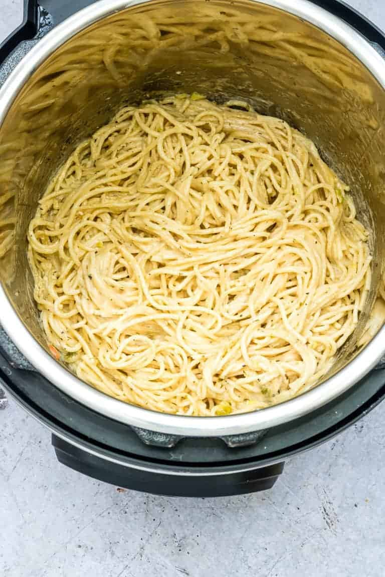 Instant Pot Spaghetti with a cheesy garlic butter sauce inside the Instant Pot