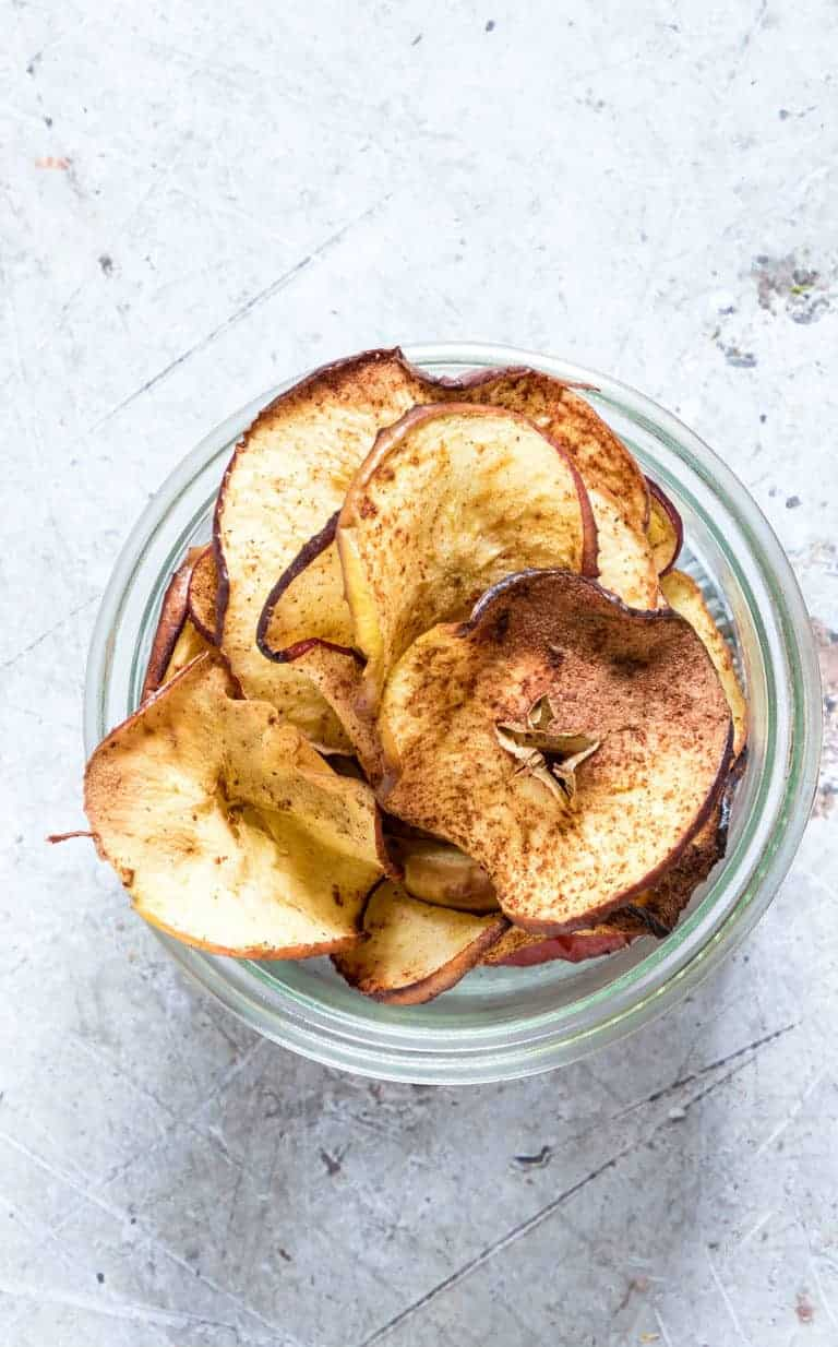 Air Fryer Apple Chips served in a small glass bowl