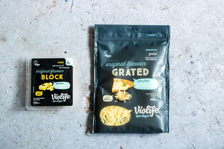 Violife block vegan cheese product and Voilife Grated vegan cheese product package placed on a counter top