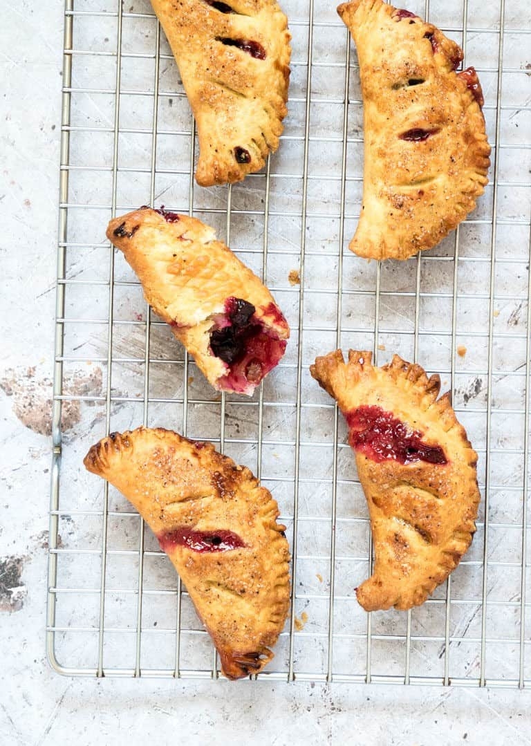blueberry hand pies on a wire cooling rack