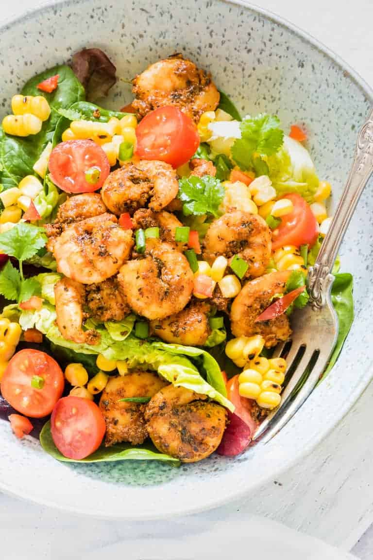 Close up of a portion of this Cajun Shrimp Salad Recipe served in a bowl with a fork